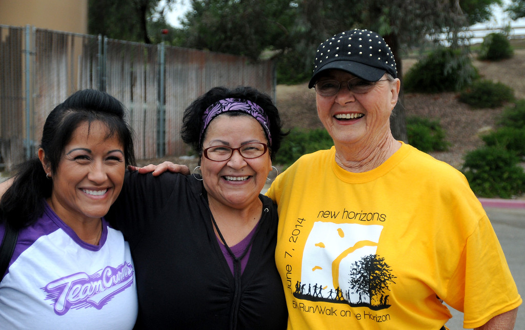 . Sisters Imelda and Sylvia Shields pose for a picture with Susan Stearns.  New Horizons, the North Hills nonprofit celebrated its 60 years of serving special needs adults Saturday, June 7, 2014, during a 5K walk/run at Hansen Dam with a fitness, health and business expo.  (Photo by Dean Musgrove/Los Angeles Daily News)