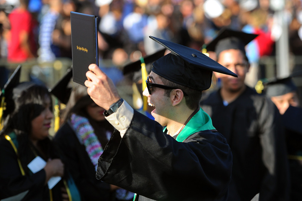 . Navy veteran Erick Andino shows his diploma board to relatives at the Los Angeles Valley College graduation, Tuesday, June 10, 2014. (Photo by Michael Owen Baker/Los Angeles Daily News)