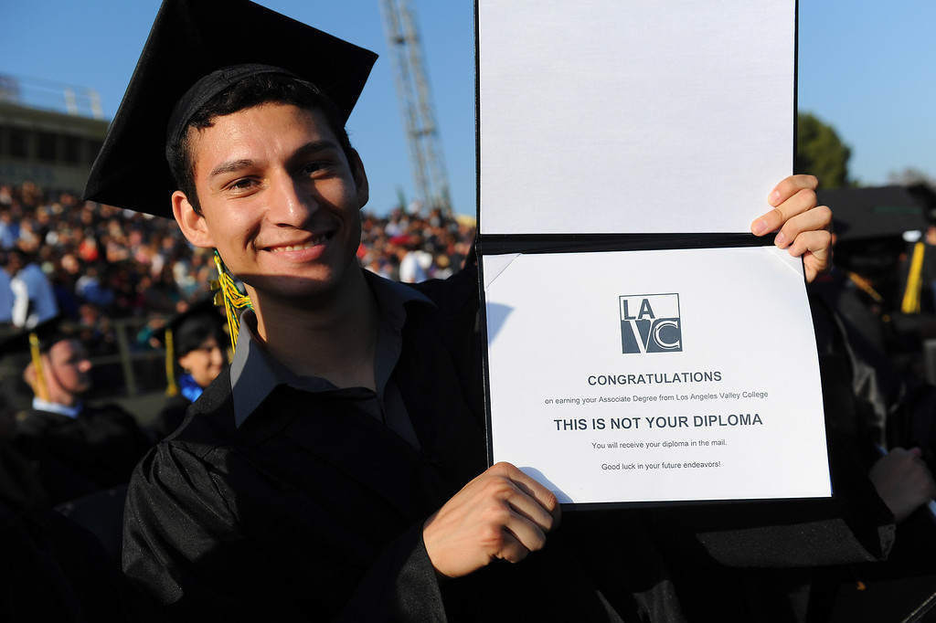 . Eduardo Gonzalez shows his (non) diploma at the Los Angeles Valley College graduation, Tuesday, June 10, 2014. (Photo by Michael Owen Baker/Los Angeles Daily News)