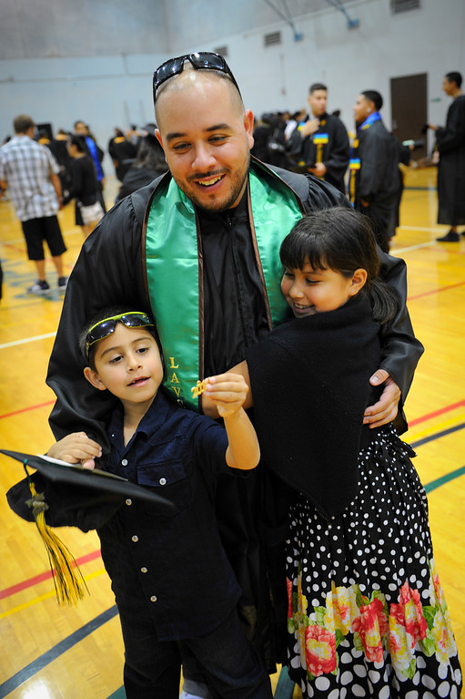 . Marine Corps veteran Jose Padilla, who served three times in Iraq, stands his son Anthony, 6, and daughter Kelly, 8, before the Valley College graduation, Tuesday, June 10, 2014. (Photo by Michael Owen Baker/Los Angeles Daily News)