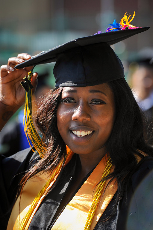 . Shacara Watts, graduating summa cum laude, attaches the tassel while waiting in line for the Los Angeles Valley College graduation, Tuesday, June 10, 2014. (Photo by Michael Owen Baker/Los Angeles Daily News)