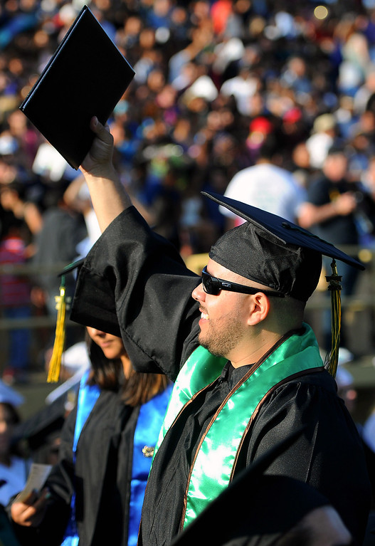 . Marine Corps veteran Jose Padilla shows his diploma to relatives at the Los Angles Valley College graduation, Tuesday, June 10, 2014. (Photo by Michael Owen Baker/Los Angeles Daily News)