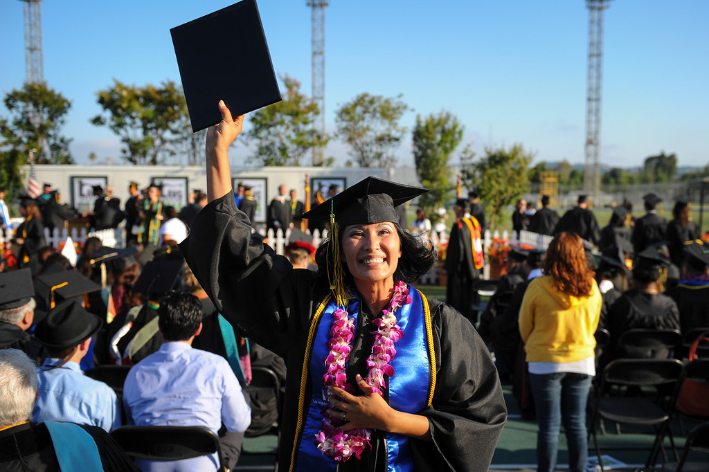 . Martha Romero waves to family at the Los Angeles Valley College graduation ceremony, Tuesday, June 10, 2014. (Photo by Michael Owen Baker/Los Angeles Daily News)