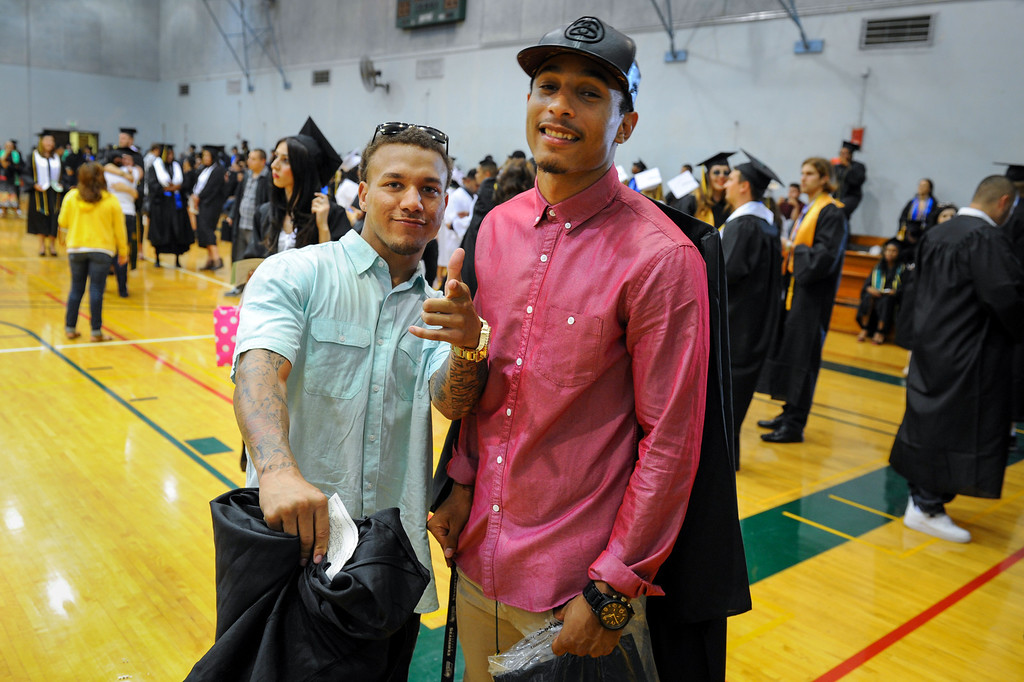 . Spencer Elrod, left, and Jeremi Ross before the Valley College graduation, Tuesday, June 10, 2014. (Photo by Michael Owen Baker/Los Angeles Daily News)