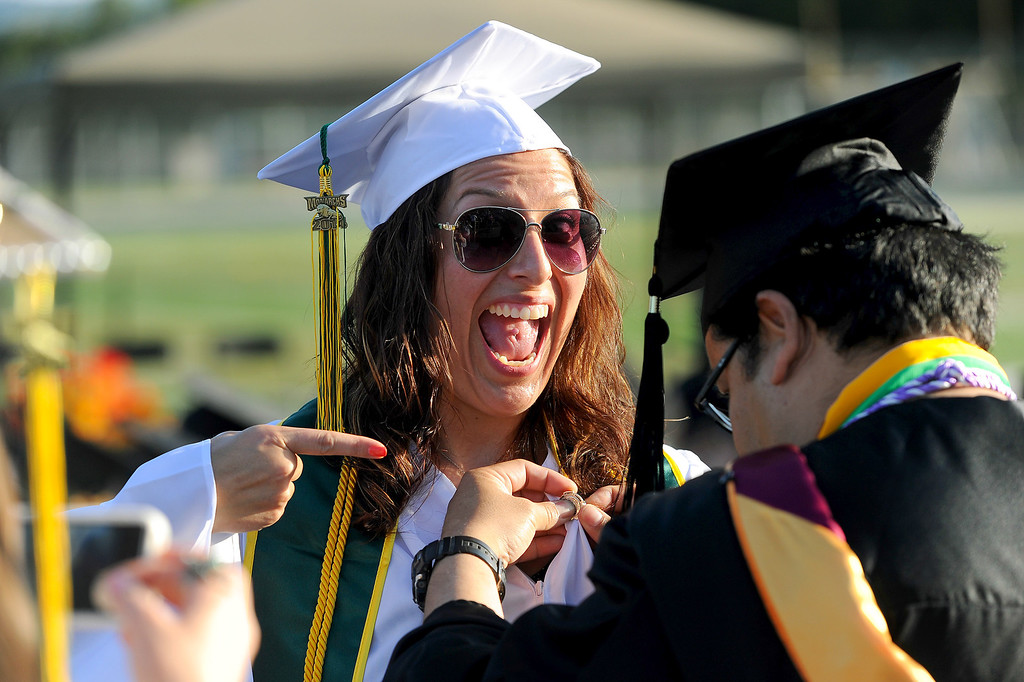 . Clorinda Guerrero gets a nursing pin pinned on by assistant professor of nursing Trig Nuyda at the Los Angeles Valley College graduation, Tuesday, June 10, 2014. (Photo by Michael Owen Baker/Los Angeles Daily News)