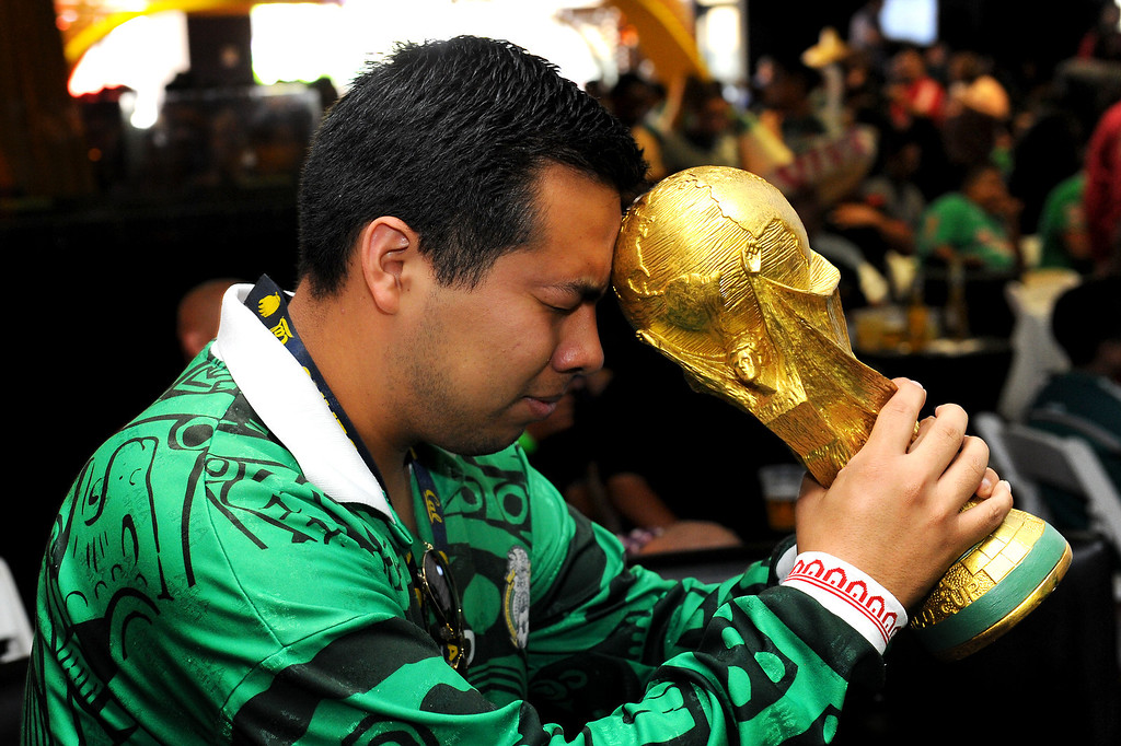 . Jose Altamirano heads a World Cup trophy at the Mexico vs Brazil viewing party at the Conga Room at L.A. Live, Tuesday, June 17, 2014. (Photo by Michael Owen Baker/Los Angeles Daily News)