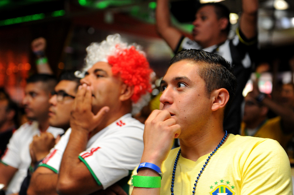 . Soccer fans watch the Mexico vs Brazil game at a viewing party at the Conga Room at L.A. Live, Tuesday, June 17, 2014. (Photo by Michael Owen Baker/Los Angeles Daily News)