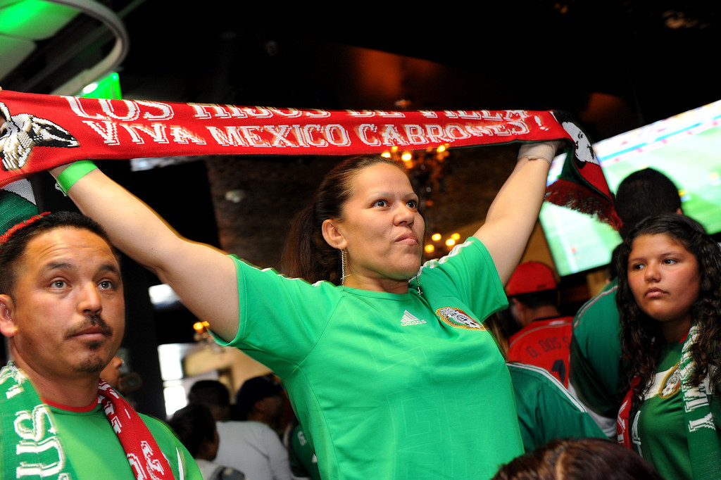 . Mexico soccer fans watch the Mexico vs Brazil World Cup game at viewing party at the Conga Room at L.A. Live, Tuesday, June 17, 2014. (Photo by Michael Owen Baker/Los Angeles Daily News)