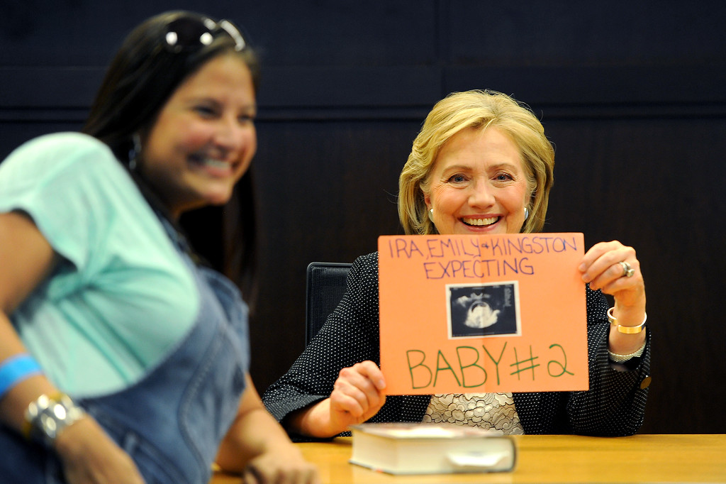 . Hillary Rodham Clinton takes a picture with Emily Amilhussin at Clinton\'s book signing at Barnes & Noble at The Grove, Thursday, June 19, 2014. (Photo by Michael Owen Baker/Los Angeles Daily News)