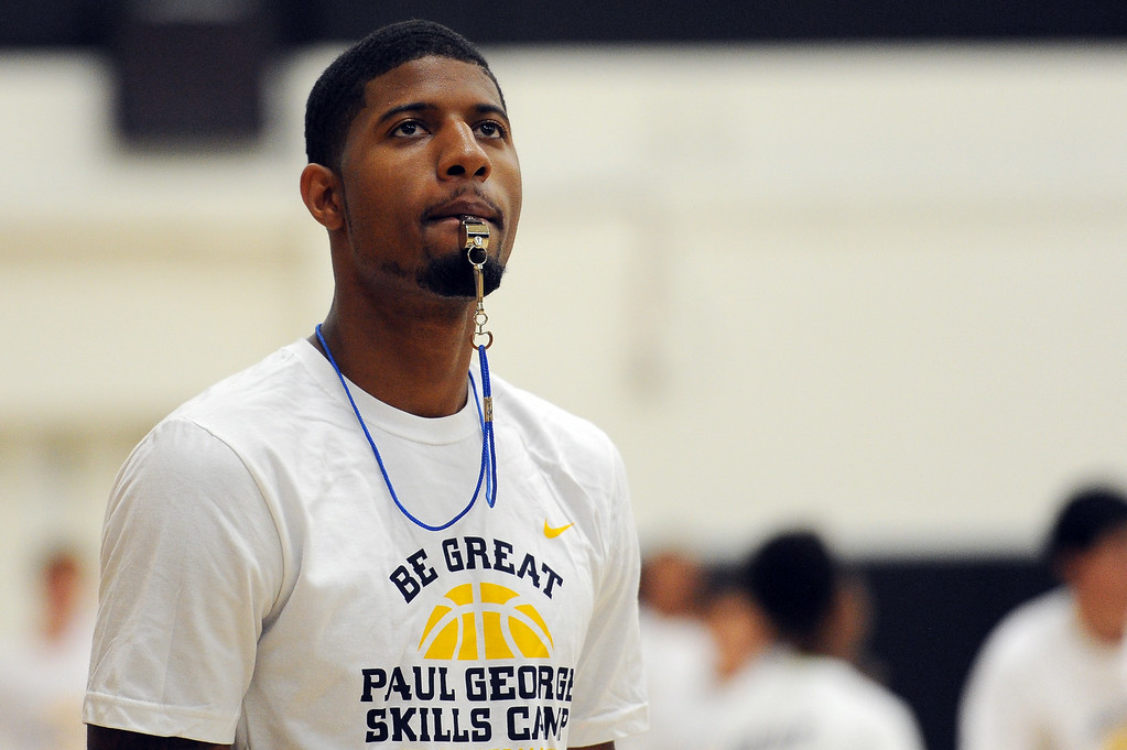 . Indiana Pacer Paul George coaches children during his annual summer youth basketball camp at Heritage Christian School in North Hills Saturday, July 19, 2014. (Photo by Hans Gutknecht/Los Angeles Daily News)