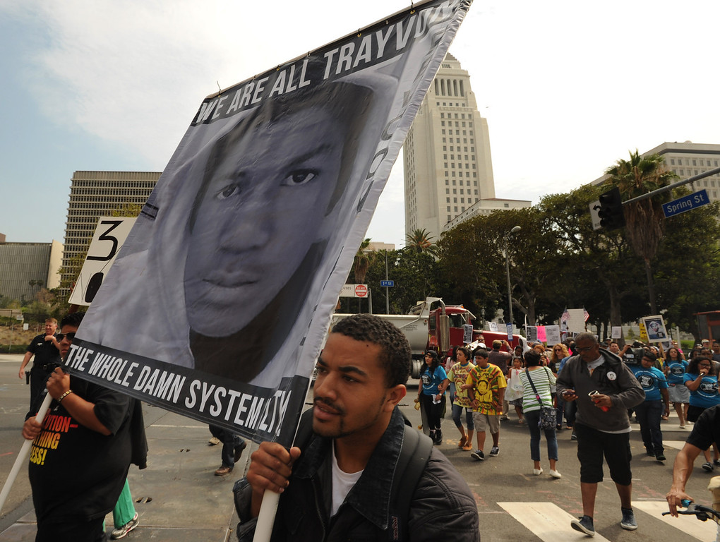 ". Protestors march down Spring street near City Hall. Earlier, they gathered in front of the Los Angeles Federal Court Building as part of what the National Action Network have called for a ""Day of Solidarity.\"" After the gathering, people splintered off in a march that was headed for Leimert Park. Elsewhere, demonstrations include protests and vigils on the front steps of federal court buildings nationwide. Los Angeles, CA. 7/20/2013(John McCoy/LA Daily News)"