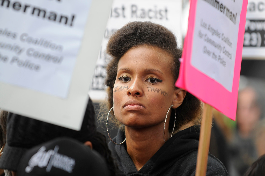 ". Keesha Clark has her message written across her face. Protestors gathered in front of the Los Angeles Federal Court Building as part of what the National Action Network have called for a ""Day of Solidarity.\"" After the gathering, people splintered off in a march that was headed for Leimert Park. Elsewhere, demonstrations include protests and vigils on the front steps of federal court buildings nationwide. Los Angeles, CA. 7/20/2013(John McCoy/LA Daily News)"