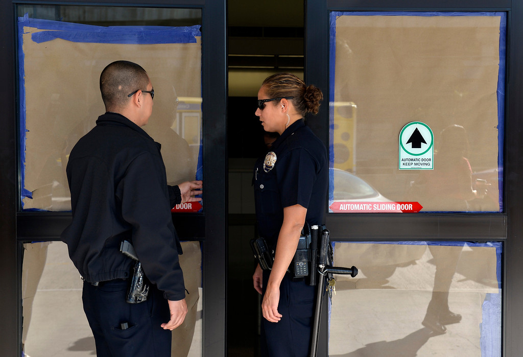 . Police officers keep one of the main doors closed and taped up to terminal 3 at LAX after a shooting the day before in Los Angeles, CA. Saturday November 2, 2013. (Thomas R. Cordova/Press-Telegram/Daily Breeze)