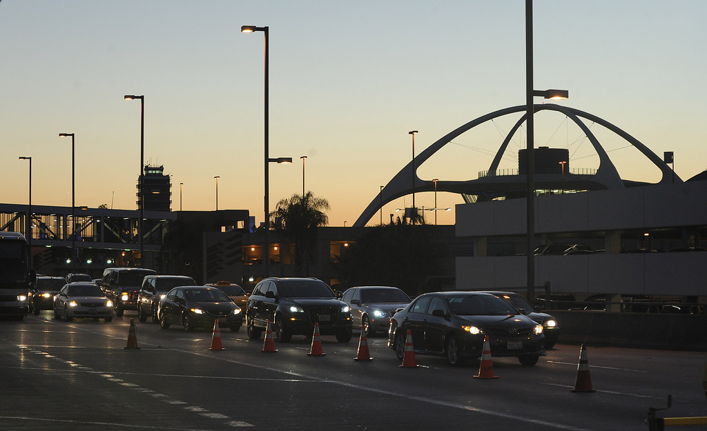 . Traffic drives into the departure level the day after a gunman entered terminal 3 at Los Angeles International Airport where he killed a TSA agent and wounded several others. Los Angeles, CA. 11/2/2013. photo by (John McCoy/Los Angeles Daily News)