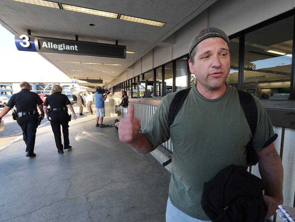 . James Rusk from Fort Collins, Colorado talks about his experience while standing outside Terminal 3 at LAX.  Friday morning a gunman entered the terminal 3 at Los Angeles International Airport and killed a TSA agent and wounded several others. Los Angeles, CA. 11/2/2013. photo by (John McCoy/Los Angeles Daily News)