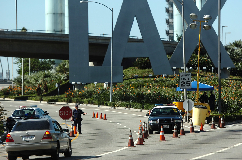 . Police officers man a check point on entering LAX after a shooting the day before in Los Angeles, CA. Saturday November 2, 2013.  (Thomas R. Cordova/Press-Telegram/Daily Breeze)