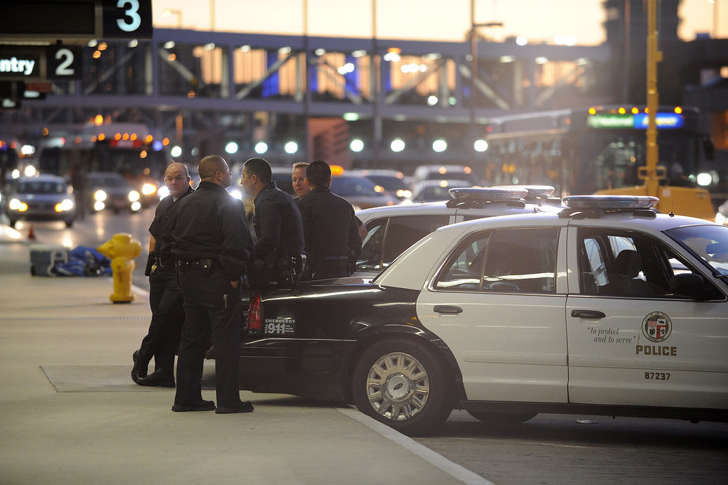 . Police officers are stationed in the departure level the day after a gunman entered terminal 3 at Los Angeles International Airport where he killed a TSA agent and wounded several others. Los Angeles, CA. 11/2/2013. photo by (John McCoy/Los Angeles Daily News)
