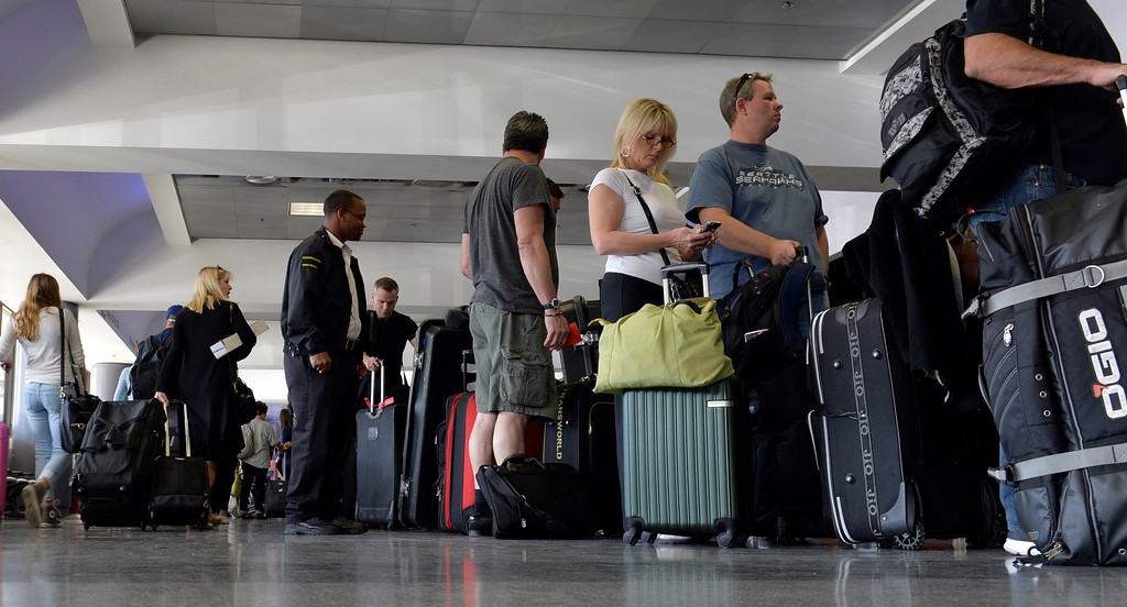 . Passengers line up in terminal 3 at LAX as it reopens after a shooting the day before in Los Angeles, CA. Saturday November 2, 2013. (Thomas R. Cordova/Press-Telegram/Daily Breeze)