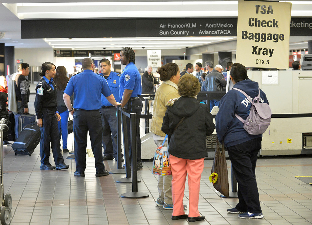 . TSA agents and passengers in Terminal 3 the day after a gunman entered the terminal at Los Angeles International Airport and killed a TSA agent and wounded several others. Los Angeles, CA. 11/2/2013. photo by (John McCoy/Los Angeles Daily News)