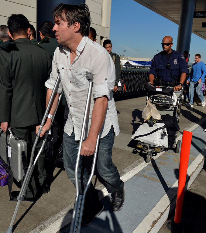 . Bruce Reith, of Germany, makes his way to his terminal on crouches after the day he was injured during the LAX shooting the day before in Los Angeles, CA. Saturday November 2, 2013. (Thomas R. Cordova/Press-Telegram/Daily Breeze)