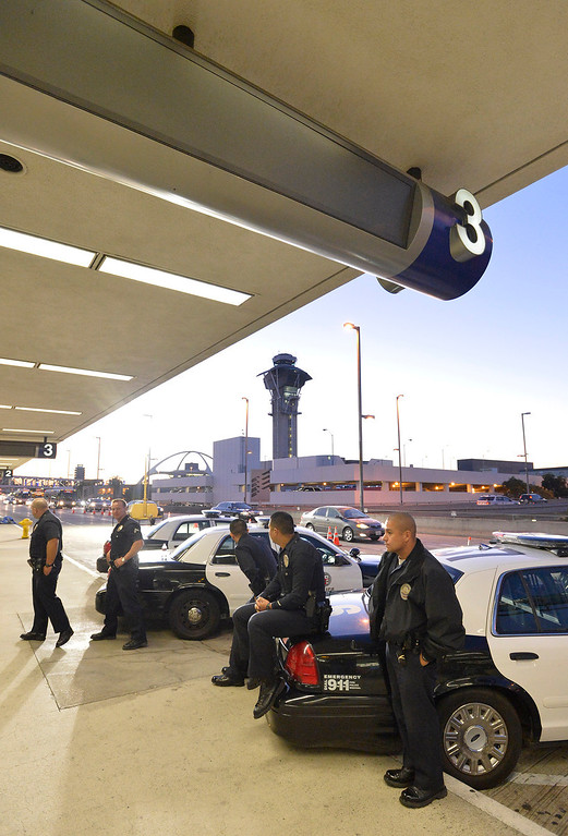 . Los Angeles Police Officers, LAPD, stand on watch outside Terminal 3 at Los Angeles International Airport the day after a gunman entered the terminal and killed a TSA agent and wounded several others. Los Angeles, CA. 11/2/2013. photo by (John McCoy/Los Angeles Daily News)