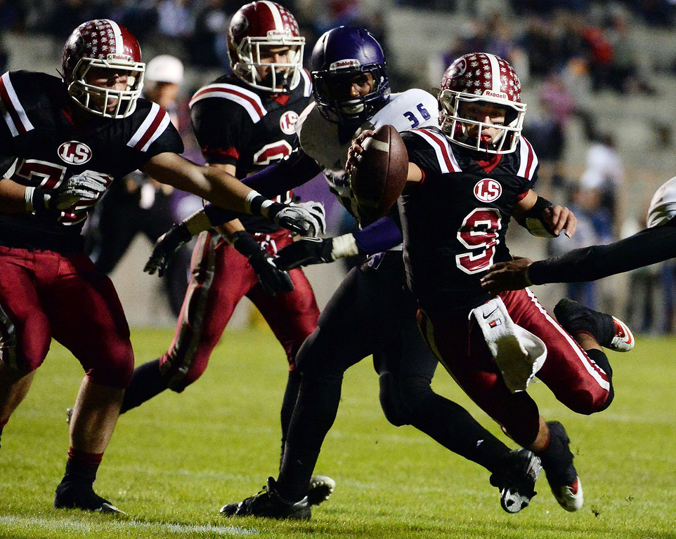 . La Serna quarterback Frankie Palmer (9) dives for a touchdown against Norwalk in the first half of a CIF-SS Southeast Division championship football game at Cal State Fullerton stadium in Fullerton, Calif., on Saturday, Dec. 7, 2013. 