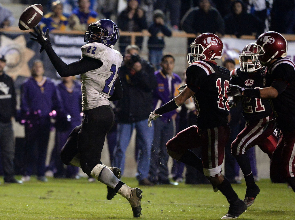 . Norwalk\'s Rashaad Penny (22) can\'t catch a pass in over-time against La Serna during a CIF-SS Southeast Division championship football game at Cal State Fullerton stadium in Fullerton, Calif., on Saturday, Dec. 7, 2013. La Serna won 41-38 in double over-time.   (Keith Birmingham Pasadena Star-News)