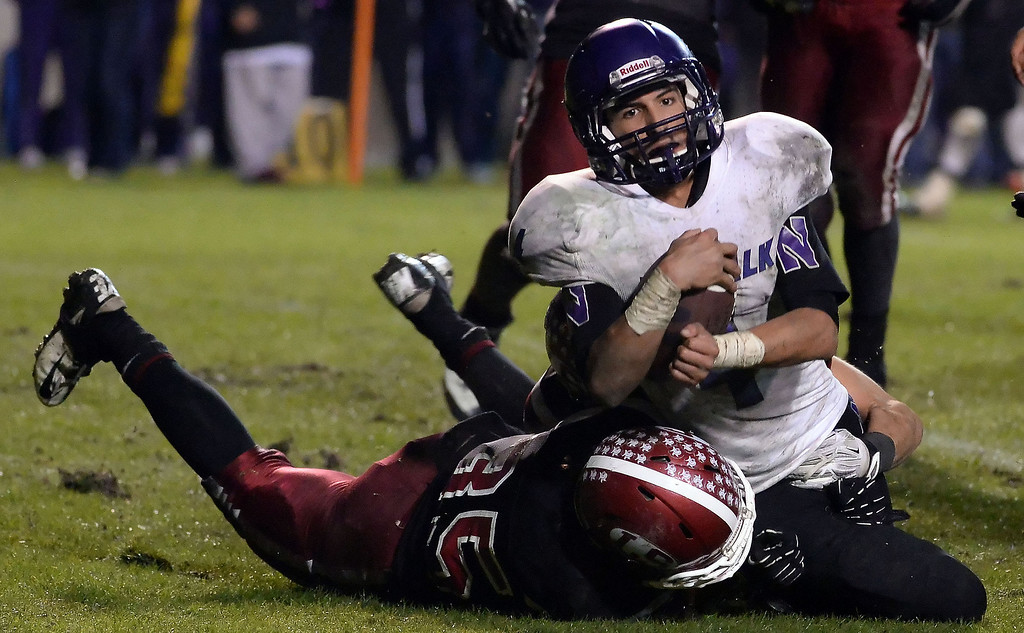 . Norwalk\'s Jacob Carr (4) is tackled by La Serna\'s Tony Ceron (35) in over-time during a CIF-SS Southeast Division championship football game at Cal State Fullerton stadium in Fullerton, Calif., on Saturday, Dec. 7, 2013. La Serna won 41-38 in double over-time.   (Keith Birmingham Pasadena Star-News)
