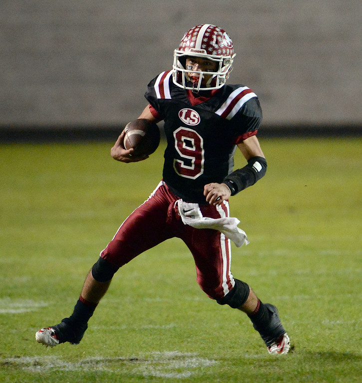 . La Serna quarterback Frankie Palmer (9) scrambles for a first down against Norwalk in the first half of a CIF-SS Southeast Division championship football game at Cal State Fullerton stadium in Fullerton, Calif., on Saturday, Dec. 7, 2013. 