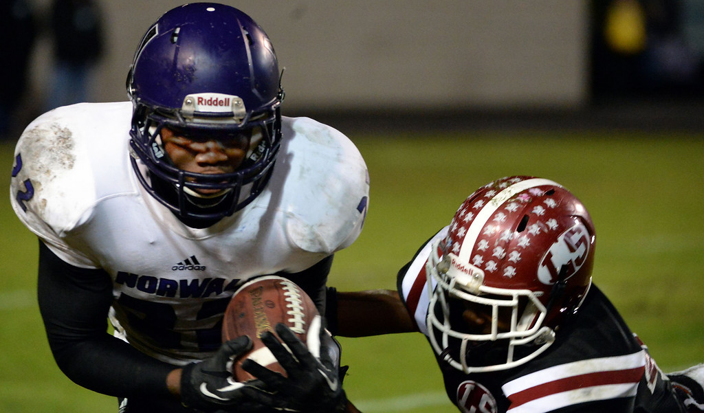 . Norwalk\'s Rashaad Penny (22) catches a pass for a first down against La Serna in the first half of a CIF-SS Southeast Division championship football game at Cal State Fullerton stadium in Fullerton, Calif., on Saturday, Dec. 7, 2013.   (Keith Birmingham Pasadena Star-News)
