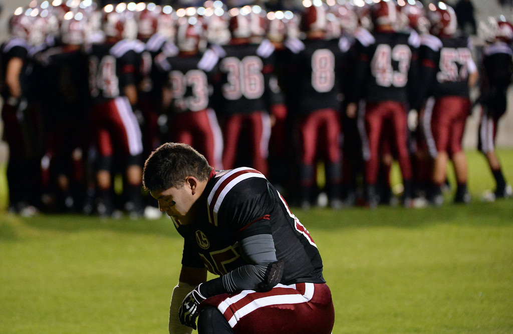 . La Serna\'s Luis Camacho takes a moment prior to a CIF-SS Southeast Division championship football game against Norwalk at Cal State Fullerton stadium in Fullerton, Calif., on Saturday, Dec. 7, 2013.   (Keith Birmingham Pasadena Star-News)