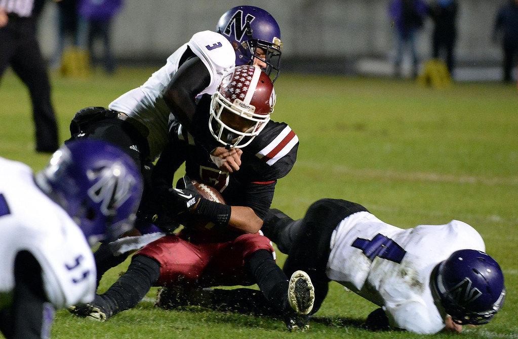 . Norwalk\'s Nick Fernandez (3) tackles La Serna\'s D\'Andre Sanchez (7) in the first half of a CIF-SS Southeast Division championship football game at Cal State Fullerton stadium in Fullerton, Calif., on Saturday, Dec. 7, 2013. 