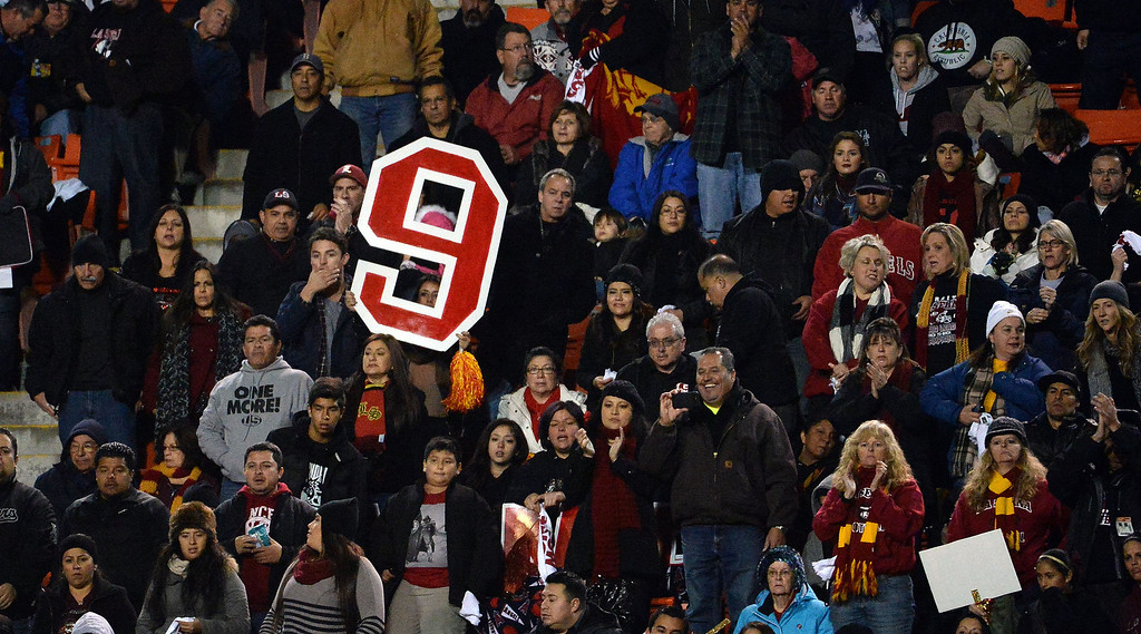 . La Serna fans show their support for quarterback Frankie Palmer (9) in the first half of a CIF-SS Southeast Division championship football game against Norwalk at Cal State Fullerton stadium in Fullerton, Calif., on Saturday, Dec. 7, 2013. 