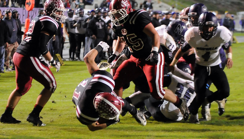 . La Serna\'s Kevin Ramos (11) dives for the touchdown against Norwalk in the first half of a CIF-SS Southeast Division championship football game at Cal State Fullerton stadium in Fullerton, Calif., on Saturday, Dec. 7, 2013. 