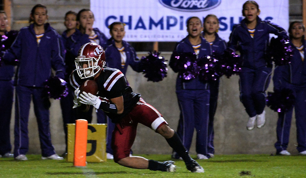 . La Serna\'s Matthew Rosales catches a 19 yard pass on 4th and 4 from quarterback Frankie Palmer (not pictured) in double over-time to defeat Norwalk 41-38 during a CIF-SS Southeast Division championship football game at Cal State Fullerton stadium in Fullerton, Calif., on Saturday, Dec. 7, 2013. 