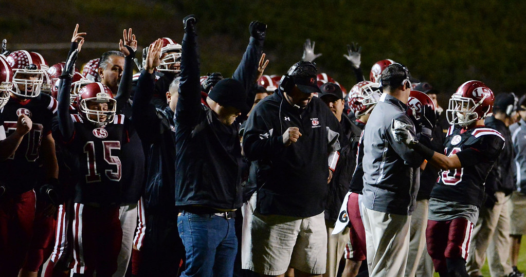 . La Serna reics after a touchdown against Norwalk n the first half of a CIF-SS Southeast Division championship football game at Cal State Fullerton stadium in Fullerton, Calif., on Saturday, Dec. 7, 2013. 