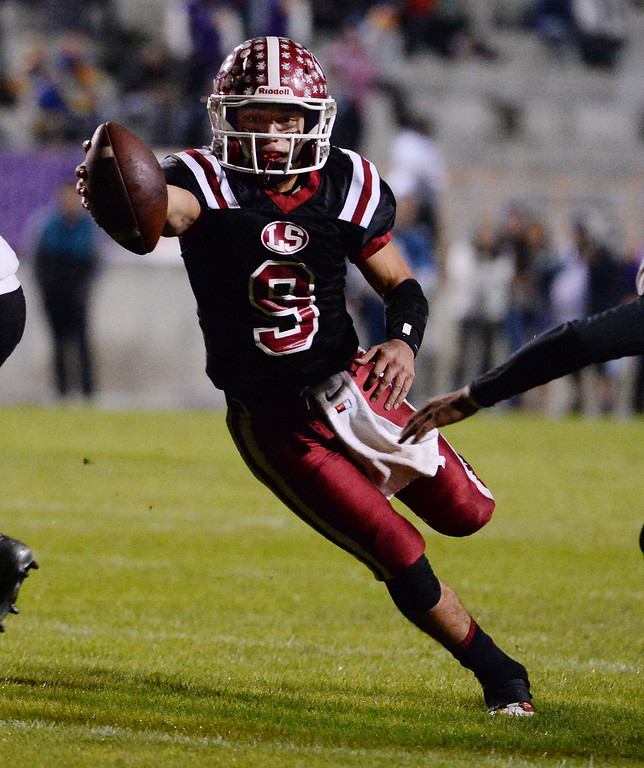 . La Serna quarterback Frankie Palmer (9) runs for a touchdown against Norwalk in the first half of a CIF-SS Southeast Division championship football game at Cal State Fullerton stadium in Fullerton, Calif., on Saturday, Dec. 7, 2013. 