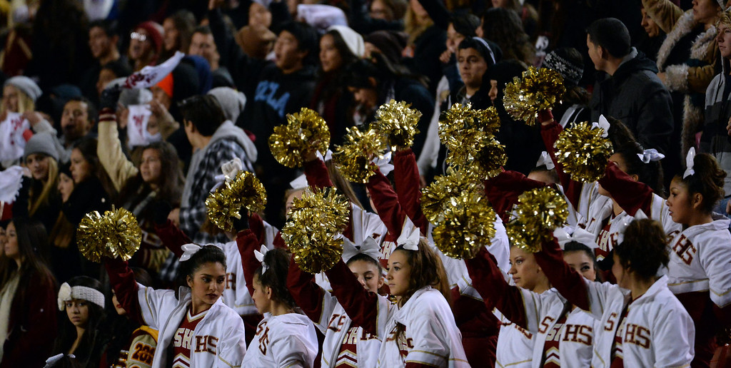 . La Serna cheerleaders react after a touchdown against Norwalk in the first half of a CIF-SS Southeast Division championship football game at Cal State Fullerton stadium in Fullerton, Calif., on Saturday, Dec. 7, 2013. 