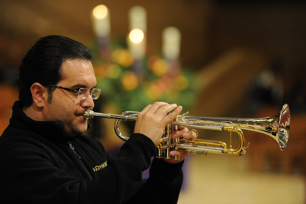 . Fernando Velacquez (cq) plays his trumpet. Singers and Mariachi rehearse the celebration in honor of Our Lady of Guadalupe at the Cathedral of the Lady of the Angels, 555 W. Temple Street.  Wednesday December 11, the annual celebration will begin at 8 p.m. with Aztec dancers on the Cathedral Plaza. At 10 p.m. the celebration continues inside the Cathedral for a special Rosary. Los Angeles, CA. 12/7/2013, photo by (John McCoy/Los Angeles Daily News)