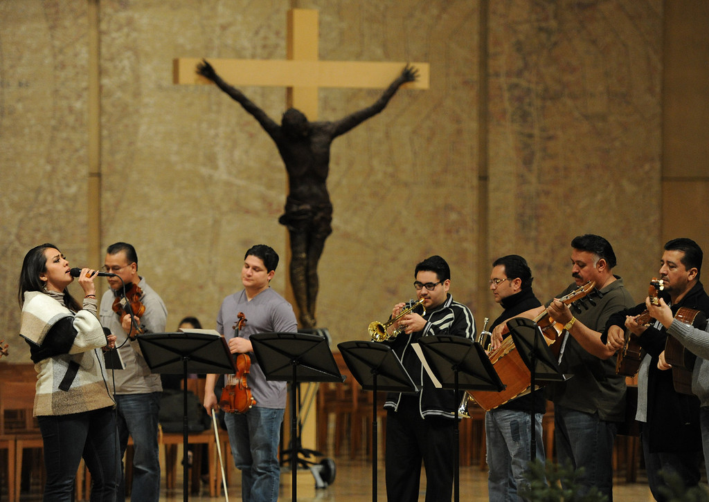 . Miraim Solis sings. Singers and Mariachi rehearse the celebration in honor of Our Lady of Guadalupe at the Cathedral of the Lady of the Angels, 555 W. Temple Street.  Wednesday December 11, the annual celebration will begin at 8 p.m. with Aztec dancers on the Cathedral Plaza. At 10 p.m. the celebration continues inside the Cathedral for a special Rosary. Los Angeles, CA. 12/7/2013, photo by (John McCoy/Los Angeles Daily News)