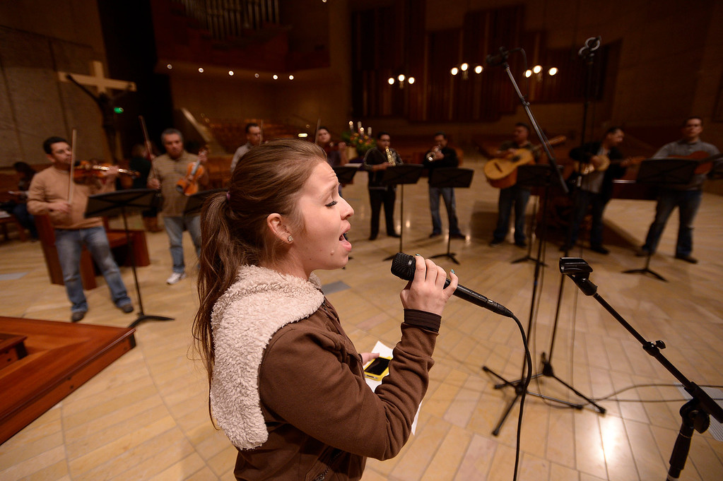 . Jackie Ibarra sings her part. Singers and Mariachi rehearse the celebration in honor of Our Lady of Guadalupe at the Cathedral of the Lady of the Angels, 555 W. Temple Street.  Wednesday December 11, the annual celebration will begin at 8 p.m. with Aztec dancers on the Cathedral Plaza. At 10 p.m. the celebration continues inside the Cathedral for a special Rosary. Los Angeles, CA. 12/7/2013, photo by (John McCoy/Los Angeles Daily News)