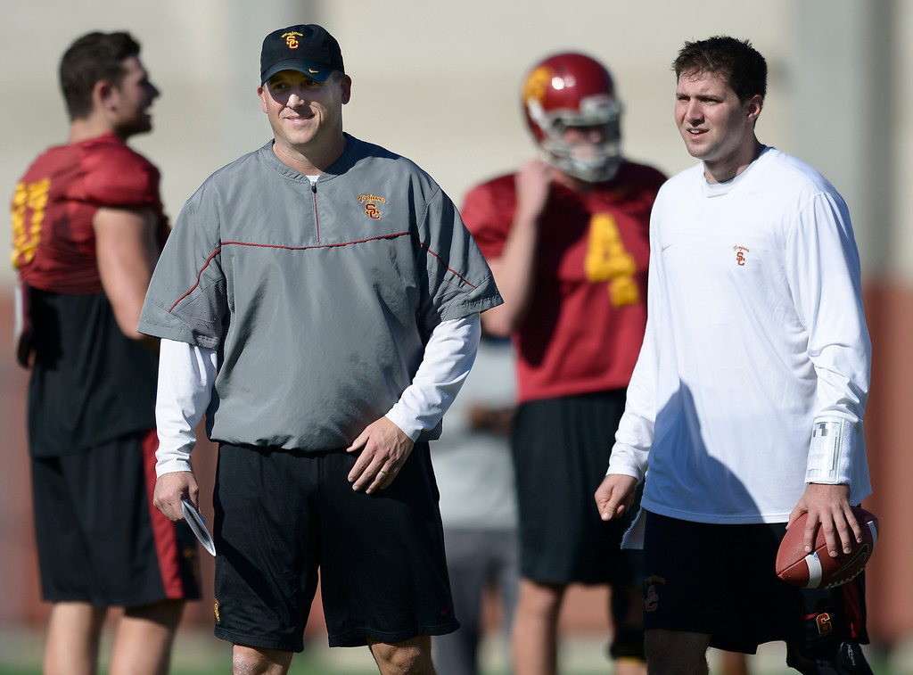 . USC Coach Clay Helton with QB Cody Kessler. USC held the final Saturday practice of the season before the Trojans play Fresno State on December 21 in Las Vegas. Los Angeles, CA. 12/14/2013, photo by (John McCoy/Los Angeles Daily News)