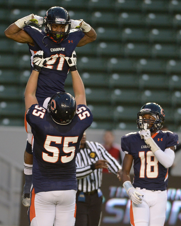. Chaminade#22 Eric Schiff is hoisted into the air by Chaminade#55 Ty Moya after scoring a touchdown in the 3rd quarter. Chaminade defeated Enterprise 41-9 to win the CIF Division II State Championship. Carson, CA 12-21-2013. photo by (John McCoy/Los Angeles Daily News)