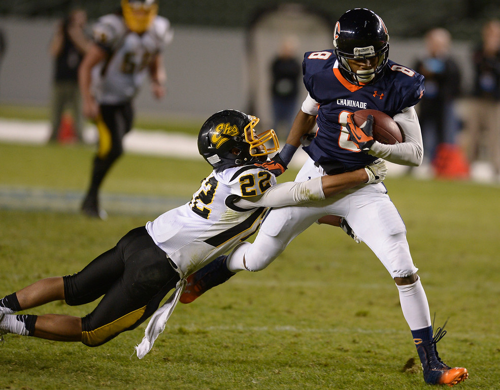. Chaminade#8 Dymond Lee hauls in a 3rd quarter reception against Enterprise#22 Kobe Williams. Chaminade defeated Enterprise 41-9 to win the CIF Division II State Championship. Carson, CA 12-21-2013. photo by (John McCoy/Los Angeles Daily News)