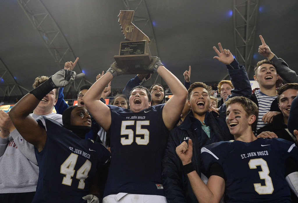 . St. John Bosco\'s Malik Dorton (44), Matthew Katnik (55) and Josh Rosen (3) jumps into the stands to celebrate with fans their win against De La Salle in the CIF State Football Bowl Championships Saturday, December 21, 2013, at the Stub Hub Center in Carson, CA.   Bosco won 20-14. Photo by Steve McCrank/DailyBreeze
