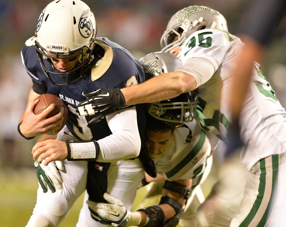 . Bosco\'s QB Josh Rosen gets tackled by DeLa Salle defenders during the CIF State Football Bowl Championship in Carson, CA. Saturday December 21, 2013. (Thomas R. Cordova/Press-Telegram/Daily Breeze)