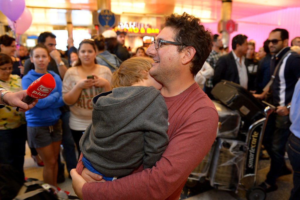 . Larry Hummel carries his sleeping son Sasha Hummel, 4, through LAX after arriving from France, Saturday, December 28, 2013, after a French court reaffirmed Hummel\'s parental custody. The boys\' mother, Maria Pfeifer, is accused of taking her two sons on a trip to Europe in 2012 and never returning, in violation of custody orders involving the boys\' fathers. (Photo by Michael Owen Baker/L.A. Daily News)