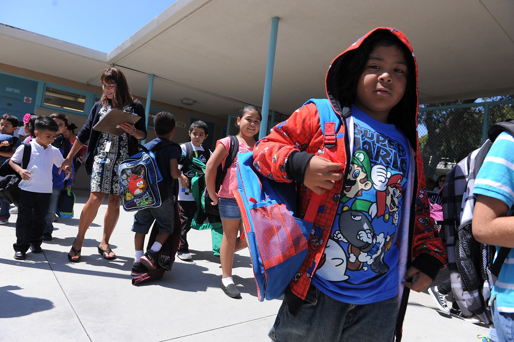 . Students at South Shores Performing Arts Magnet School in San Pedro leave school on the first day of classes.   Photo by Brad Graverson 8-13-13