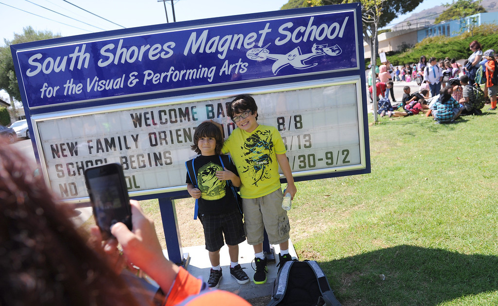. Dylan and Brandon Hay have a photo taken by their mom after the first day of school. Students at South Shores Performing Arts Magnet School in San Pedro leave school on the first day of classes.   Photo by Brad Graverson 8-13-13