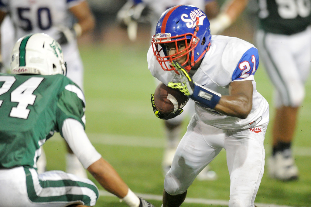 . The Serra Cavaliers\' Adoree\' Jackson carries the ball against Oceanside Pirates\' Alijah Holder in the 2013 Honor Bowl high school football game at Oceanside High School in Oceanside, CA. on Friday, September, 6 2013. (Photo by Sean Hiller/ Daily Breeze)